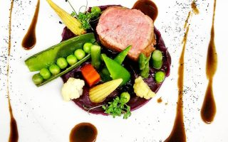 Filet of veal with violette truffle and garden vegetables