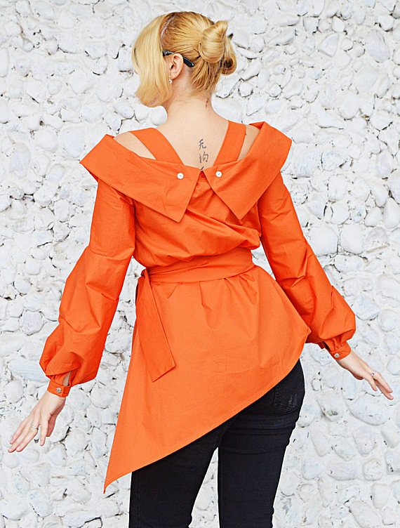 asymmetrical orange shirt