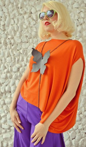 asymmetrical orange top